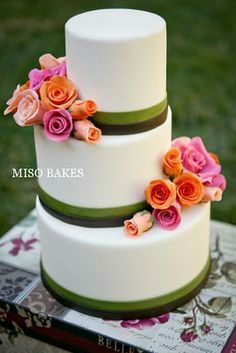 not sure about the off set of the cake, but the flowers are beautiful