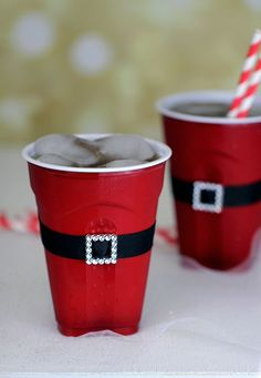 "Turn a SOLO® cup into Santa. I took plain black ribbon, buckles and glue to attached ""Santa's belt"" around my red SOLO® cups. I found these cute buckles right at Walmart in the sewing section. They were under $1 for 2. 8 Clever Holiday Party Ideas using SOLO®"