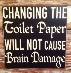 Changing The Toilet Paper Will NOT Cause Brain Damage.  Funny Wood Sign