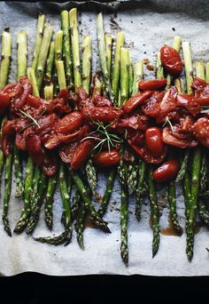 Roasted asparagus and cherry tomatoes with rosemary.