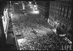 Times Square, New York. On the evening of May 8th 1945, celebrations of the surrender of Germany went well into the night, packing the streets with joyous citizens. http://newstalgia.crooksandliars.com/gordonskene/ve-day-may-8-1945