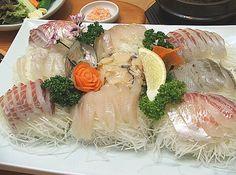 생선회(saengseonhoe) / Sliced Raw Fish  Thinly-sliced raw fish. It is served with wasabi and soy sauce and a chili and vinegar dip.
