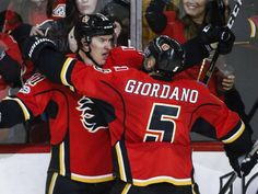 Mikael Backlund scores game-winner in overtime as Calgary Flames extend win streak to six straight with 3-2 victory over Detroit Red Wings