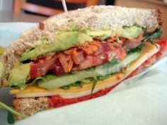 Veggie sandwich w/ avocado, cucumber, tomato, shredded carrot, cheddar, sun dried tomato pesto, and smoked gouda.  OH YUM!!!