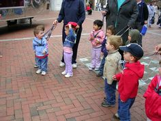 funny picture of day care #English #children on #reins while #walking around #harnesskids @HarnessKids