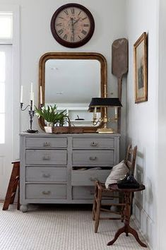 grey cabinet and mirror. I have my moms dresser set. Have never painted them but this is tempting!