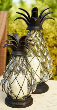 Our Pineapple Hurricane is a welcoming symbol of hospitality. When paired with candlelight, it sheds a soft glow during outdoor evenings. | Frontgate: Live Beautifully Outdoors