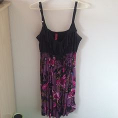 Black and purple floral dress Adjustable straps, goes a little past the knee, ruffle on the bust, tie string on the back. Elastic waste band Pure Energy Dresses