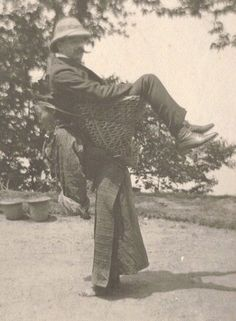 A Sikkimese lady carries a British merchant on her back. West Bengal, 1903.