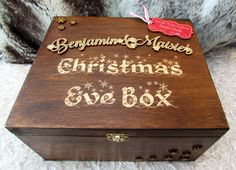 Fill this beautiful, well-finished Christmas Eve box with lots of goodies - candy cane, warm pyjamas, a Christmas DVD, cookies and some hot chocolate! This Christmas Eve box is 'vintage style' and is personalised with your child or children's names. It comes with an engraved red label which reads, 'Special Delivery from Santa Claus' and tells the child/children they are on the good list! The names are laser-engraved from wood with a detailed gold surface. Snowflakes are attached to the top…