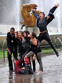 "The stars of upcoming film ""LOL: Laughing Out Loud,"" splash around until they are soaked in the Trocadero fountains ."