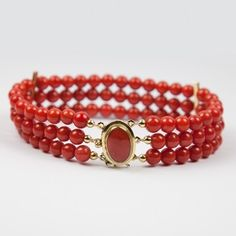 Medium hand made red coral bracelet with 3 strands of 6 mm red coral beads and accented with 18 K Italian gold clasp. The product of skilled Italian craftsmen of the town of Torre Del Greco (Italy).