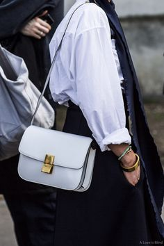 white shirt with rolled up sleeves & white Celine box bag #style #fashion #streetstyle