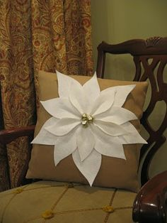 #poinsettia pillow-- I think maroon background with white or brown background with red would look good too!  Maybe dark green background with red?