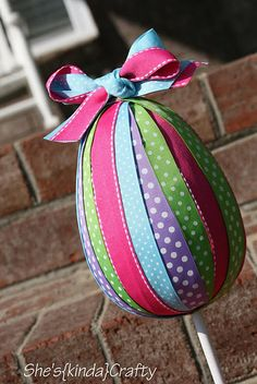 Easter egg topiary tutorial- Did this with friends and they came out great.  Beware- the dowel is hard to get in past the layers of ribbon.  Power tools were involved as we used a paper mache egg instead of styrofoam. :)