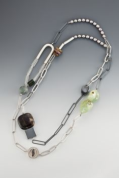 Sterling silver necklace with agate, jade, tourmaline, white moonstone, frosted crystal and pearl elements by Janis Kerman Design