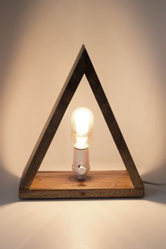 Love the warm glow of the lightbulb with the dark wood.