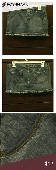 Juniors denim mini skirt New without tags / 100% cotton / front and back pockets / fabric detailing on front pockets / flower design on left back pocket / belt loops Lilu Skirts Mini