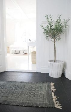 Love the rug and the olive tree, and oh yea, all the white ;)