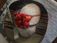 Nutella pancakes with icing sugar and fresh strawberries