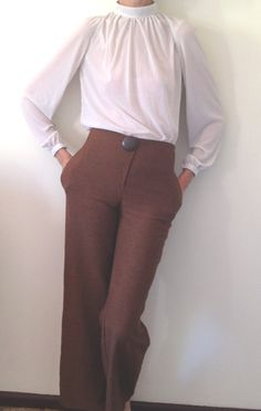 Wool blend pants, tight at the hips, but that might make them perfect for wearing with tunics.