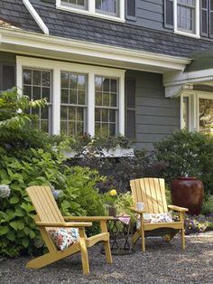 A pair of Adirondack chairs serve as the perfect spot to relax and enjoy the garden. | Photo: John Gruen
