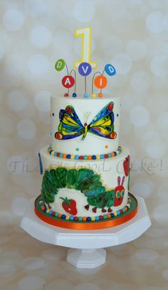 Hungry Caterpillar Buttercream iced cake with hand painted fondant details.