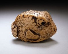 Blowfish netsuke, ivory wth sumi staining  18th c. from the collection of Raymond and Frances Bushell