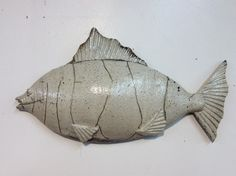 Thrown and altered stoneware fish fired in a raku kiln. There is a small notch on the back to hang on your wall. Ceramic Fish, Ceramic Animals, Raku Kiln, Gold Highlights, Stoneware, Glaze, Pottery, Sculpture, Wall