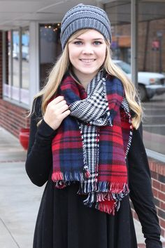 Soft and cozy reversible wrap scarf with frayed edges. One side is a red/navy mix of plaid and the other is black/white houndstooth. Wear it with both showing or just one side.