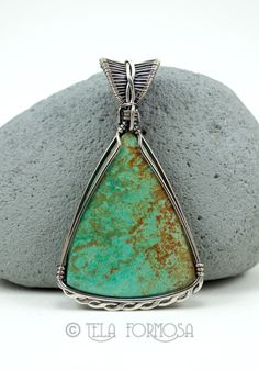 Carico Lake Turquoise wire wrapped by Tela Formosa in sterling silver.
