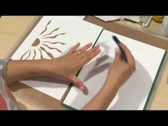 In this clip from Art Journaling 5 - Mix Up The Media , Kate Crane shows how easy it is to design a stencil, cut it out using the Gryo-Cut tool, then use a gel plate and acrylic paint to print the design onto her work. - Art Journaling 5 - Mix Up The Media - YouTube