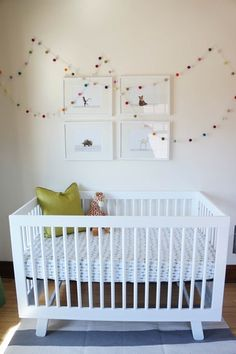 Eli's Fab Former Catch-All Room: a nursery with a neutral background that lets bright colors shine. Featuring a Babyletto Hudson 3-in-1 Convertible Crib