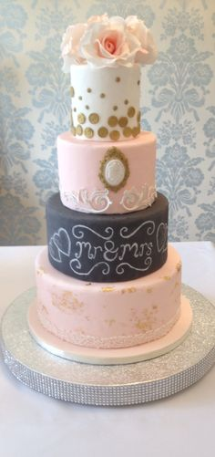 Ayda- quite simply a cake full of sophistication and charm. With a feature chalkboard tier, edible lace, real gold leaf and handcrafted two tonal sugar roses, this cake is every vintage brides dream cake!