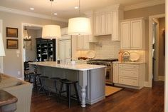 Perimeter – Homecrest Cabinetry, Maple Wood, Eastport Door, Alpine Cocoa glaze finish Island – Kemper Cabinets, Northrope Door, Maple wood, Portabello finish Hood, Island with decorative legs, two-toned kitchen, white cabinets, large drawer storage, by Kitchen Sales, Knoxville TN