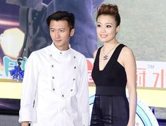 Hong Kong actor and singer Nicholas Tse and singer Joey Yung pose during the premiere of Nicholas`s new food variety show 12 'Feng' Taste in Beijing, China, July 9, 2014