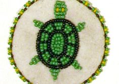 How To Make a Native American Beaded Rosette Medallion – Craft Tutorials. With a loop on back, great slider project for Webelos or Boy Scouts.