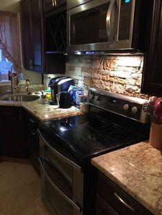 Kitchen Cabinets Java Color yellow river granite and quartz ledgestone backsplash | kitchen