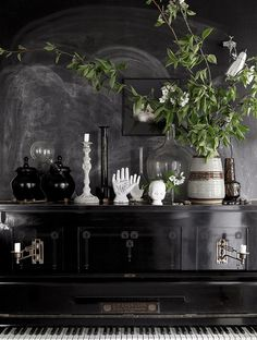 Black piano against a black wall in the inspiring Skåne home of photographer /  interior designer Daniella Witte (photos by Daniella, styling Emma Persson Lagerberg).