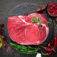 Raw beef steak on black background with cooking ingredients. Top view by sea_wave. Raw beef steak on black background with cooking ingredients. Spicy Steak, Rinder Steak, Raw Food Recipes, Beef Recipes, Great Recipes, Steaks, Fresco, Meat Butcher, Bbq Beef