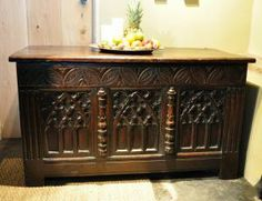 A WONDERFUL MID 16TH CENTURY ENGLISH CARVED OAK CHEST.-THE TWO PLANKED TOP ABOVE A FRONT WITH A STYLISED ARCHADED FREIZE ABOVE A THREE PANELLED FRONT, EACH CARVED WITH GOTHIC TRACERY.
