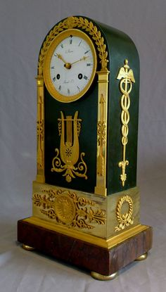 French Empire antique clock, ormolu, patinated bronze and marble signed by both Ravrio and Mesnil. - Gavin Douglas Antiques