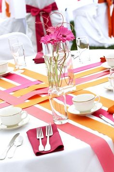 Ribbon Runners - weave in and out across tables. This would work well for round tables but might be hard to add center pieces too.