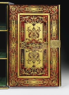 A BOULLE BRASS AND RED-TINTED-TORTOISESHELL MARQUETRY CABINET, LOUIS XIV, CIRCA 1700