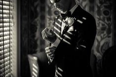 I love this shot of the groom getting ready.