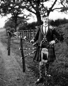 Old photograph of a Bagpiper in Pitlochry, Scotland