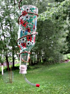 Hummingbird feeder made from a recycled clear beer bottle. Ready to hang in a favorite spot and watch the hummingbirds. Perfect for those who only