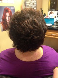 Short brown hair cut for fullness and volume and colored with a mahogany brown