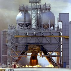 A Rocketdyne F-1 engine being tested at the Marshall Space Flight Center in Alabama. Five F-1 engines powered the first stage of the Saturn V rocket.