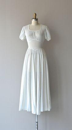 #Modest doesn't mean frumpy. #DressingWithDignity www.ColleenHammond.com Tea House dress 1940s white swiss dot dress by DearGolden
